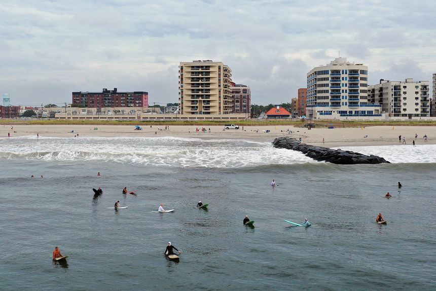 Surfers flocked to the beach in Long Beach