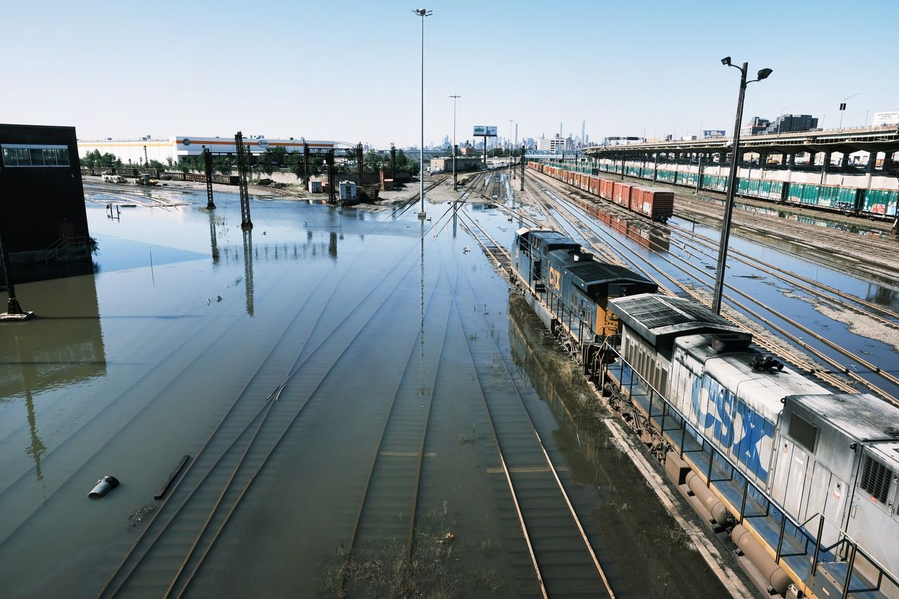 Train tracks were under water in the Bronx on Thursday after a night of heavy rain and wind